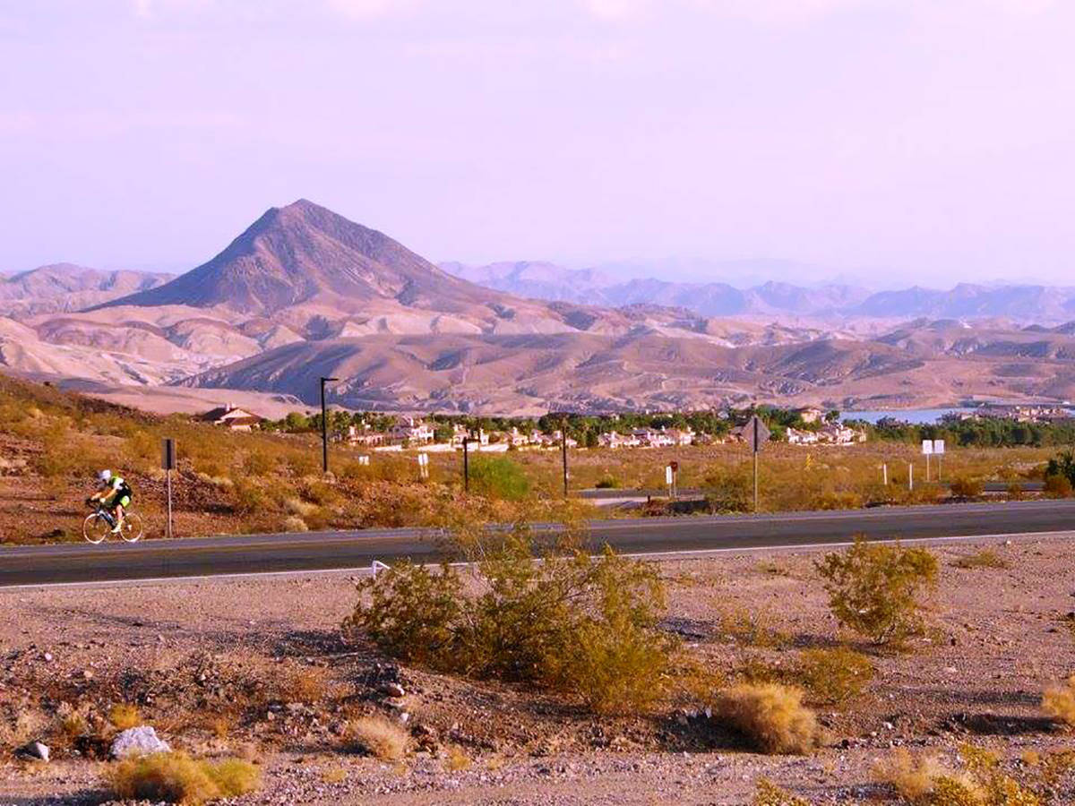 Lake Las Vegas is in the background as a bicyclist rides along Lake Mead Parkway. (Natalie Burt)