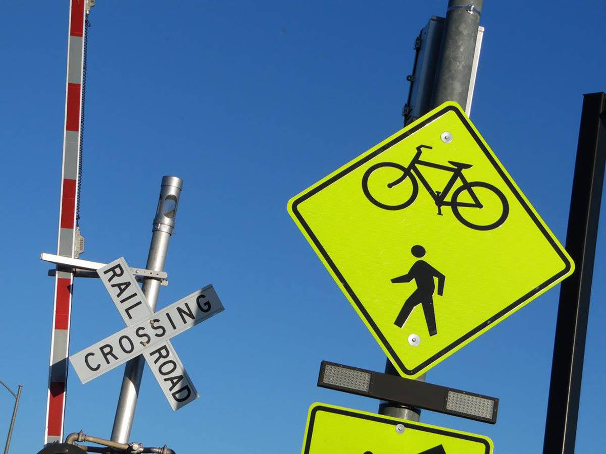 Signs encourage safe crossing at Horizon Drive to reconnect riders with the Union Pacific Railr ...