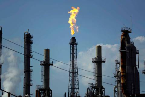 FILE - In this Thursday, Aug. 31, 2017, file photo, a flame burns at the Shell Deer Park oil re ...