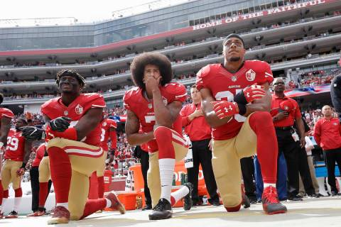 In this Oct. 2, 2016, file photo, from left, San Francisco 49ers outside linebacker Eli Harold, ...