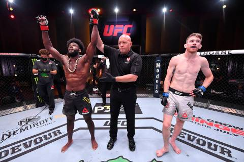 LAS VEGAS, NEVADA - JUNE 06: Aljamain Sterling celebrates after his submission victory over Cor ...