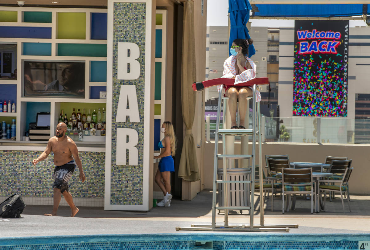 A lifeguard keeps watch as the bar is open about the pool at The Strat on Saturday, June 6, 202 ...