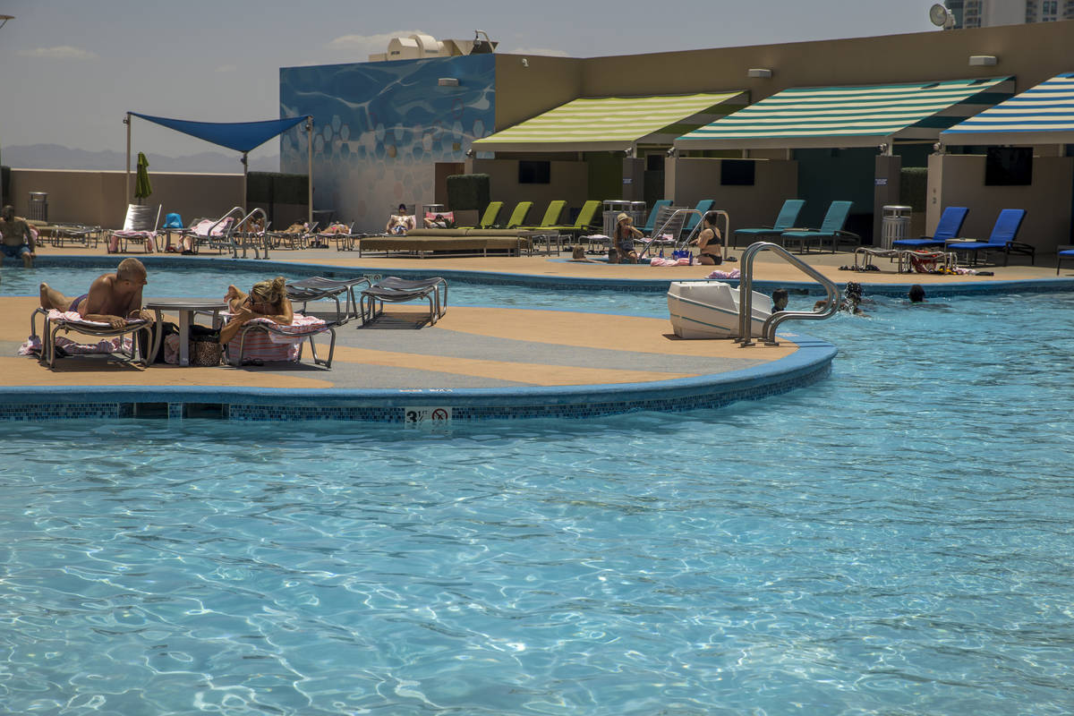 Guests enjoy the nice, cool waters of the pool at The Strat on Saturday, June 6, 2020 in Las Ve ...