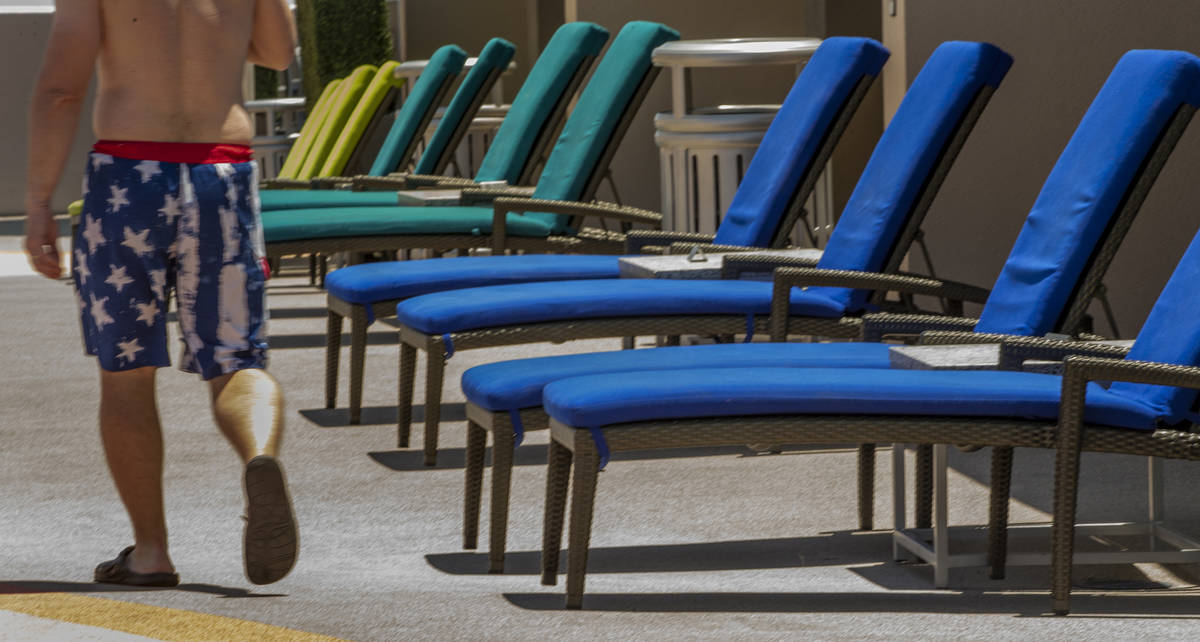 The colorful lounge chairs are set out for guests about the pool at The Strat on Saturday, June ...