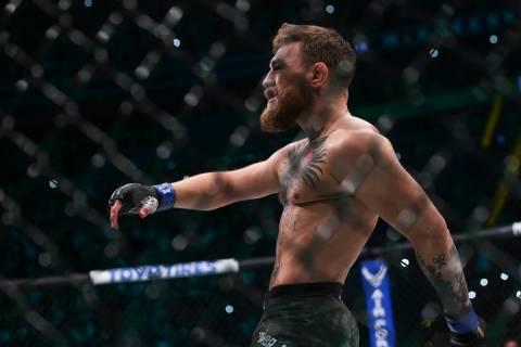 Conor McGregor enters the octagon before facing Khabib Nurmagomedov in their lightweight title ...