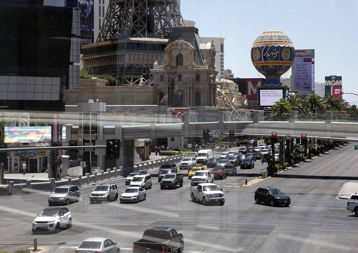 Motorists are seen at the intersection of Las Vegas Boulevard and Flamingo Road on Sunday, June ...