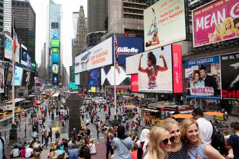 In a June 20, 2019, file photo, tourists visit Times Square in New York. After three months of ...
