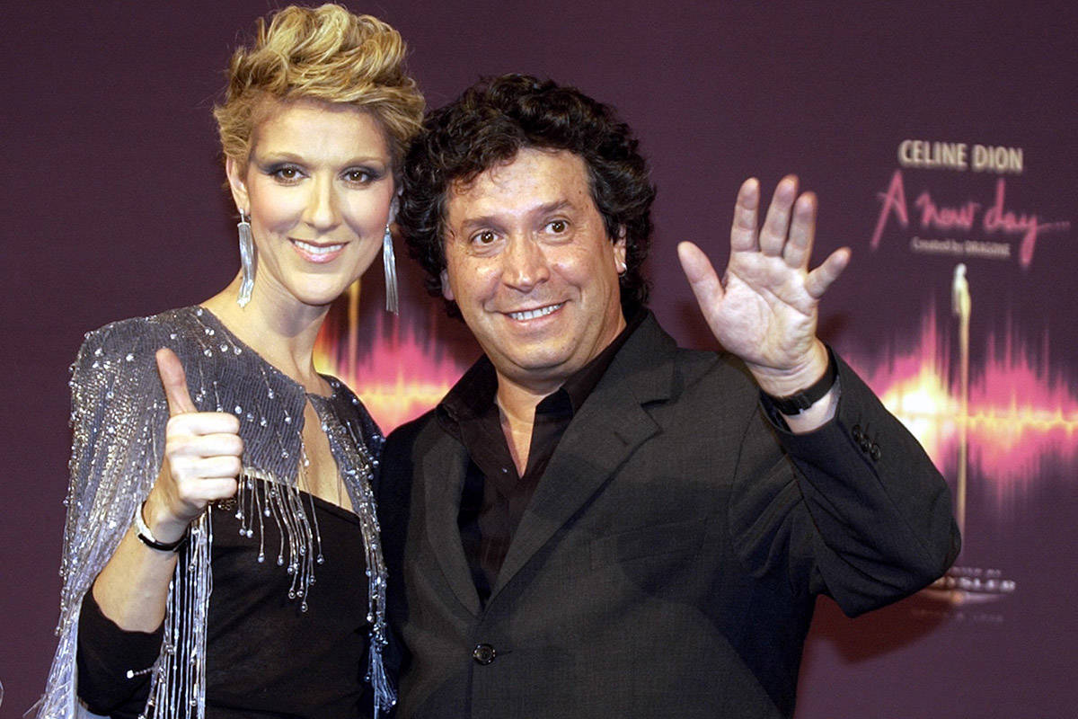 Celine Dion poses with artistic director Franco Dragone at a news conference after the opening ...