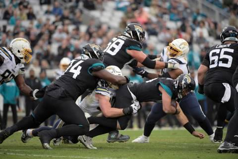 Los Angeles Chargers defensive end Joey Bosa (97) sacks Jacksonville Jaguars quarterback Gardne ...