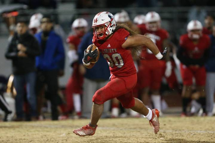 Liberty's Zyrus Fiaseu (30) runs the ball in the fourth quarter against Bishop Gorman during a ...