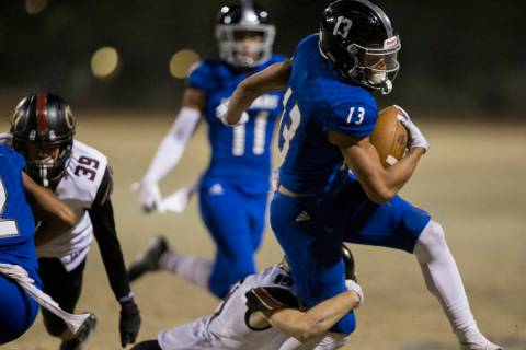 Desert Pines junior wide receiver Michael Jackson (13) makes a big run past Faith Lutheran juni ...