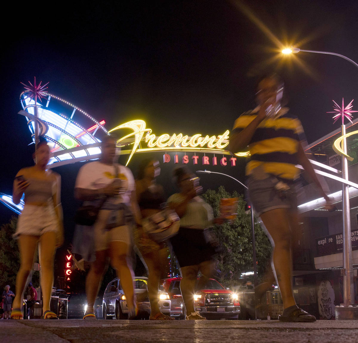 Pedestrians make way from Fremont District East into Fremont Street Experience as Phase Two of ...