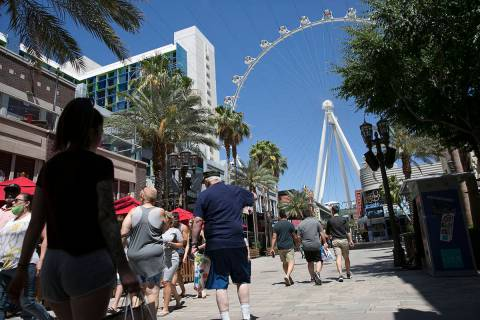 Tourists walk at The Line Promenade on Sunday, June 7, 2020, in Las Vegas.(Bizuayehu Tesfaye/La ...