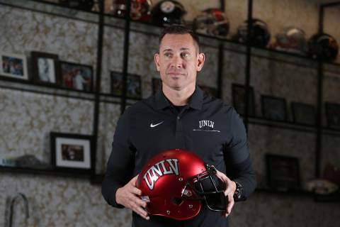 UNLV football head coach Marcus Arroyo is photographed in his office at the Fertitta Football C ...