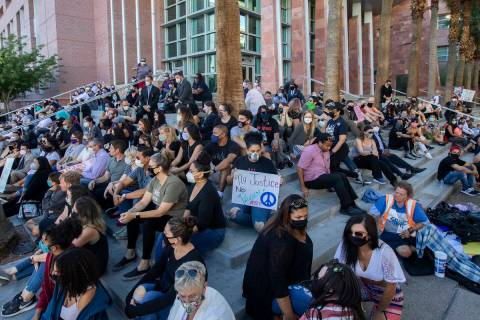 A group of public defenders and others gathered for an 8-minute, 46-second moment of silence ou ...