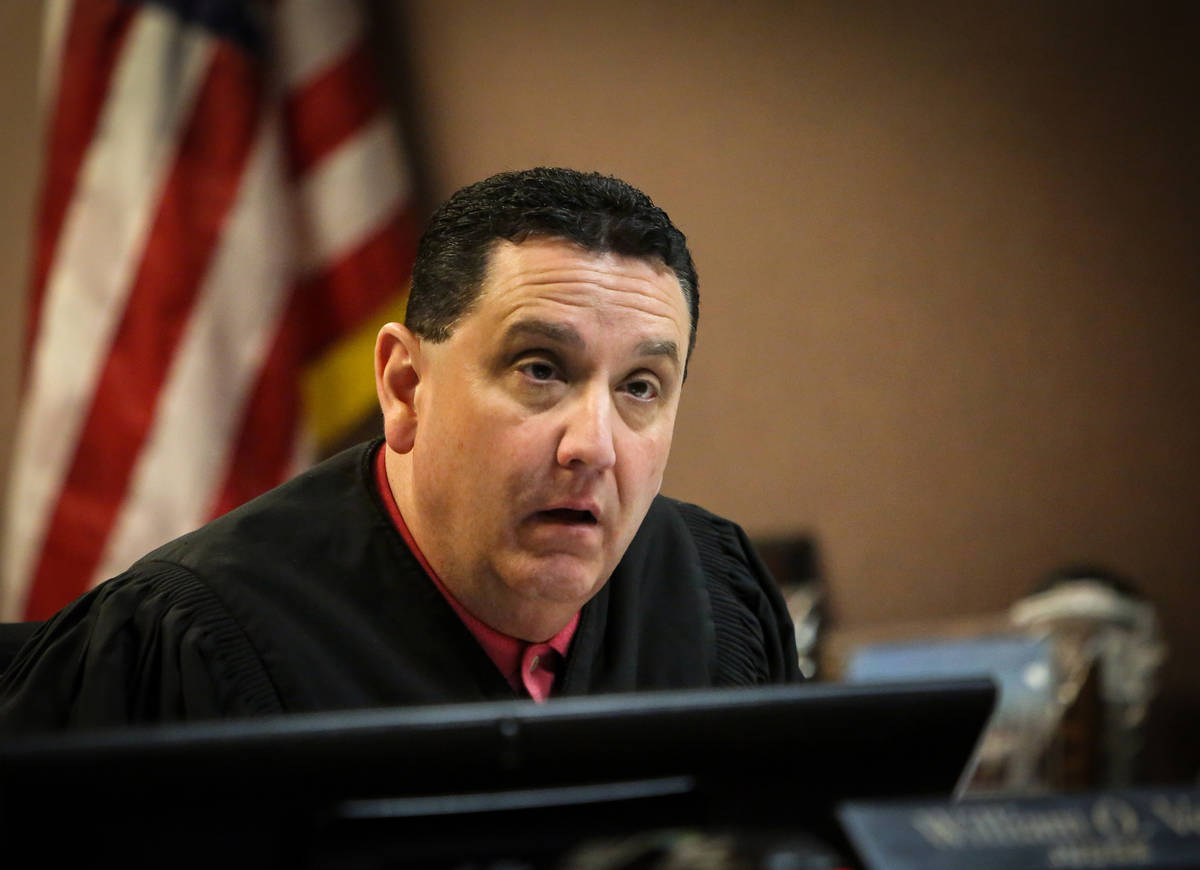 Judge William O. Voy presides over the case at the Family Courts and Services Center in Las Veg ...
