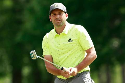 Sergio Garcia, of Spain, watches his putt on the ninth hole during the final round of the Wells ...