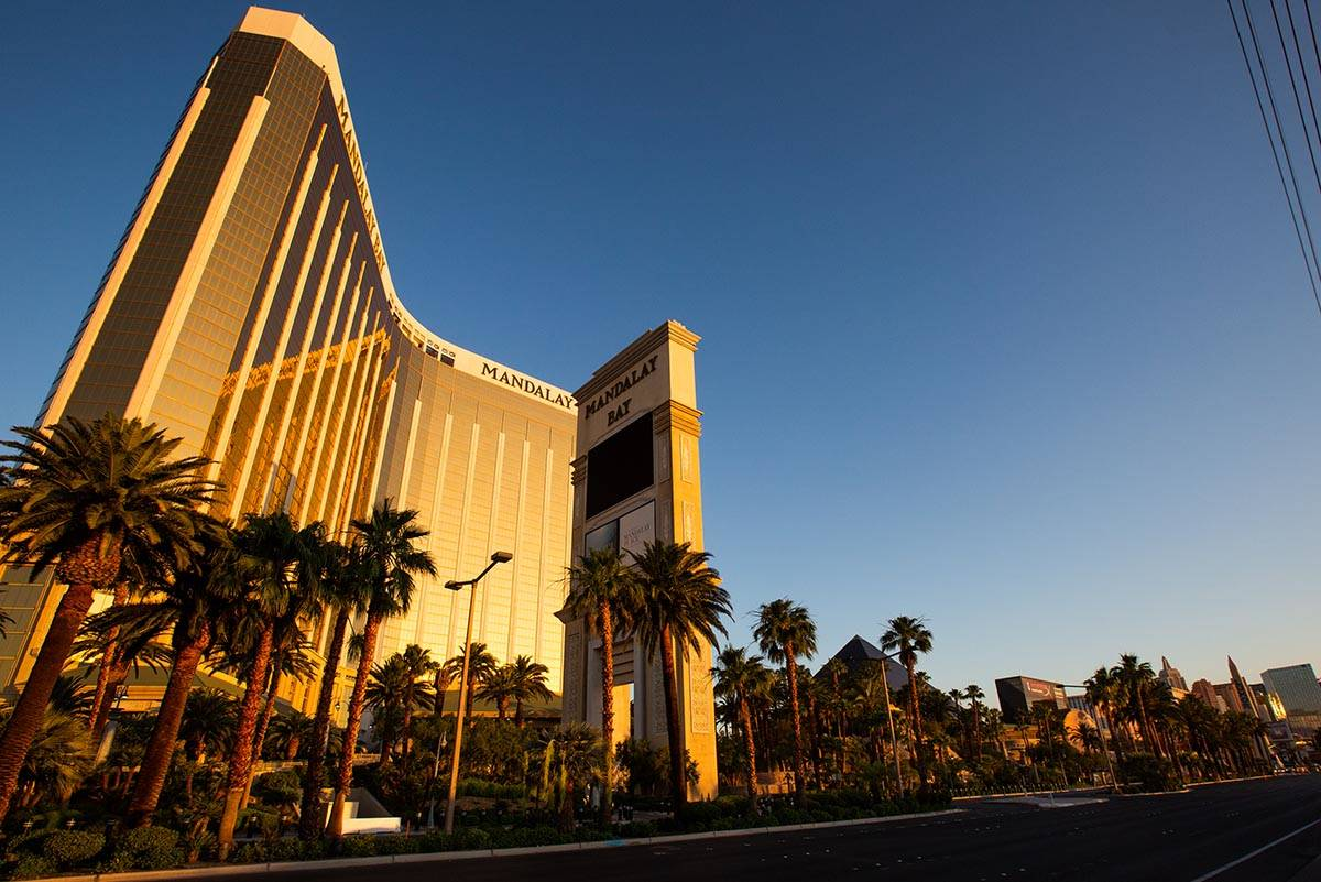 The sunrise reflects off Mandalay Bay on the Las Vegas Strip as casinos prepare to reopen on Th ...