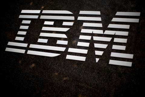 FILE- In this April 26, 2017, file photo, the IBM logo is displayed on the IBM building in Midt ...