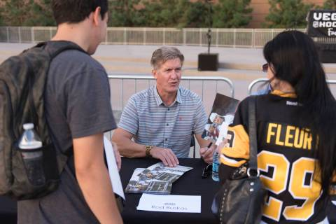 Retired NHL player Rod Buskas signs autographs during the Vegas Hockey Fan Fest at Toshiba Plaz ...