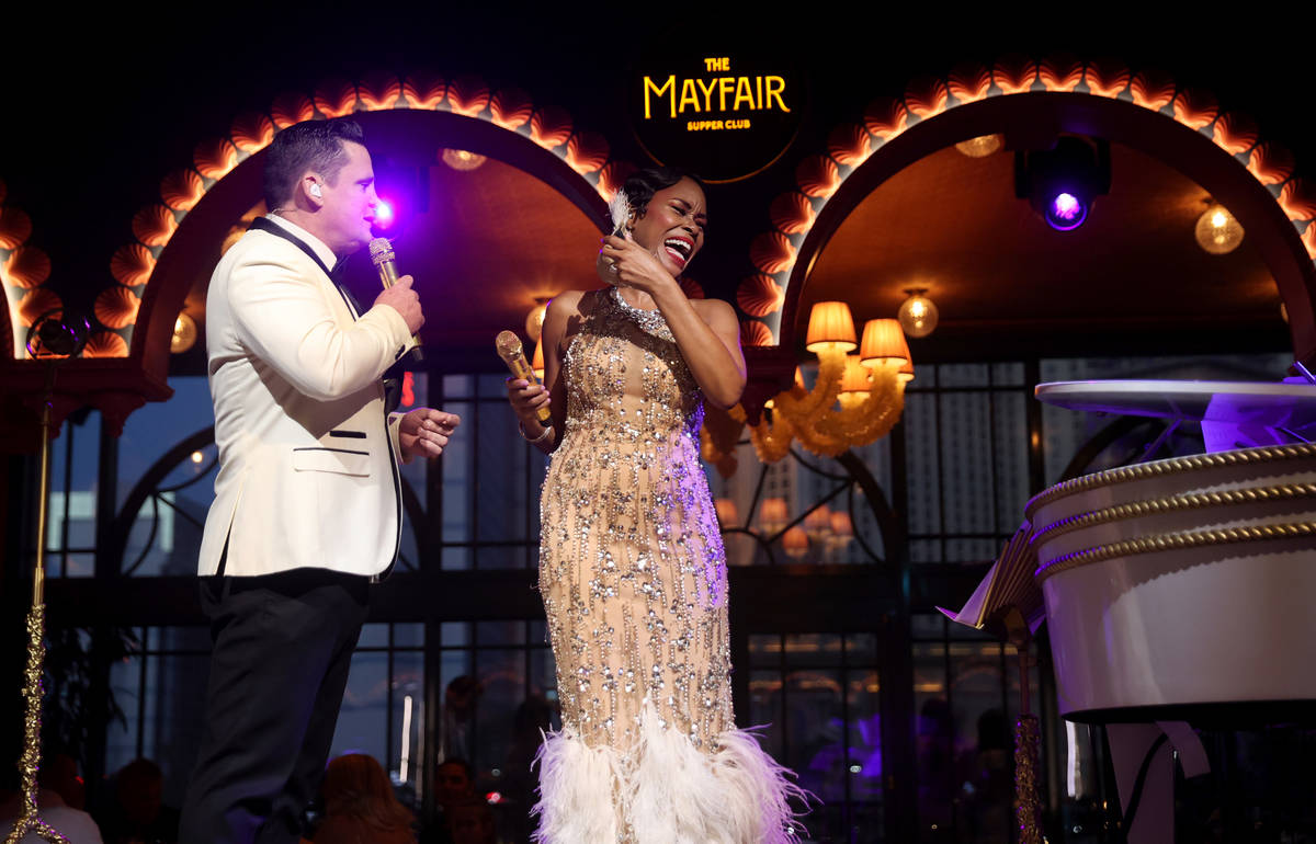 LaShonda Reese laughs as she takes off her mask as she and Steve Judkins perform at The Mayfair ...
