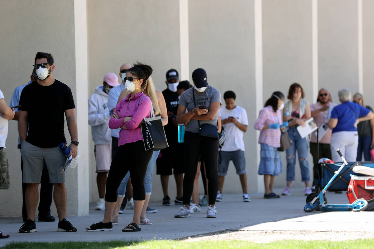 Voters who didn't receive a mailed ballot or need to make a change to their registration wait i ...