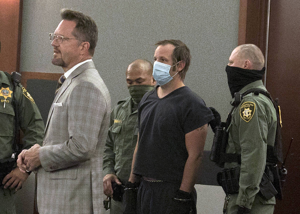 Stephen Parshall, center, one of three alleged boogaloo movement extremists charged with planni ...