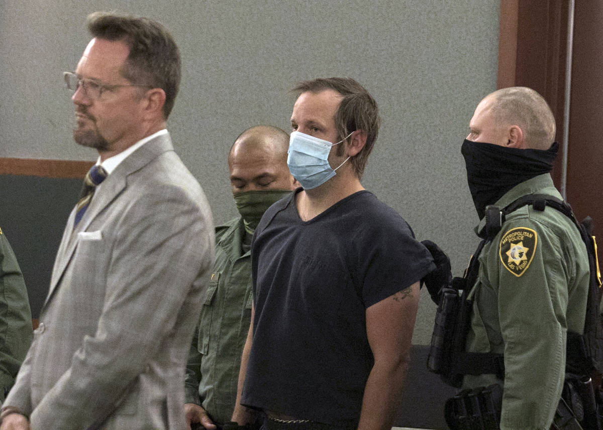 Stephen Parshall, center, one of three alleged Boogaloo Boys extremists charged with planning v ...