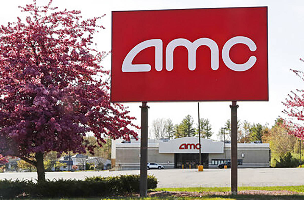 This May 14, 2020, photo shows an AMC theater sign at a nearly empty parking lot for the theate ...