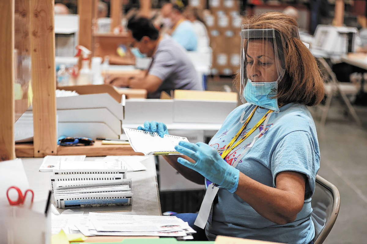 J.R. Thompson verifies ballots at the Clark County Election Department in Henderson, Wednesday, ...
