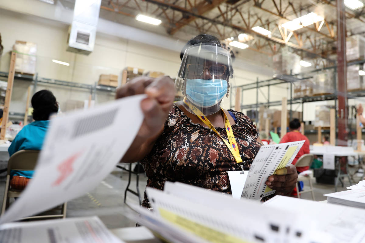Barbara Lewis verifies ballots at the Clark County Election Department in Henderson, Wednesday, ...