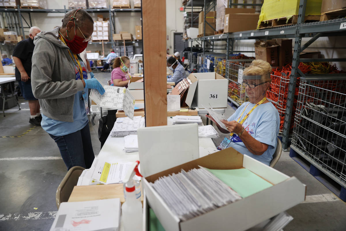 Gale Macon, left, and G. Karen Edwards count ballots at the Clark County Election Department in ...