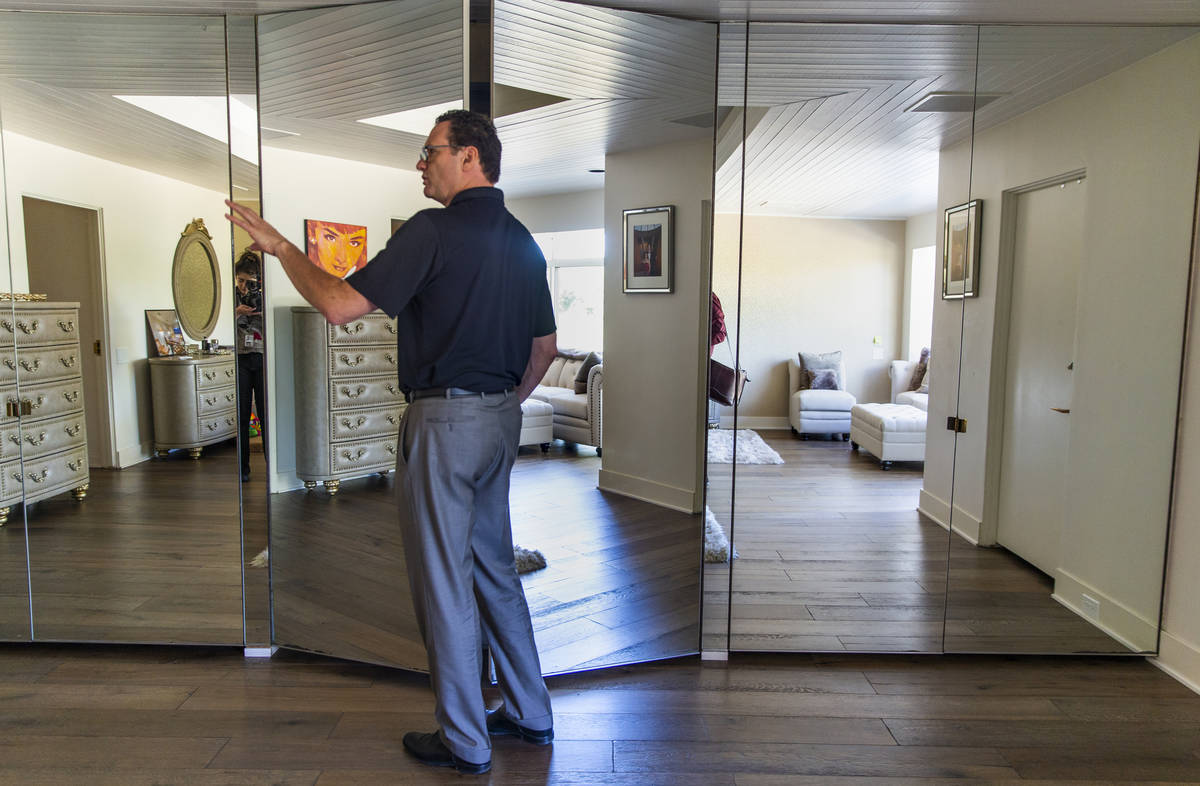 Owner Jim Morgan shows off the master bedroom during a tour of Lefty Rosenthal's former home on ...