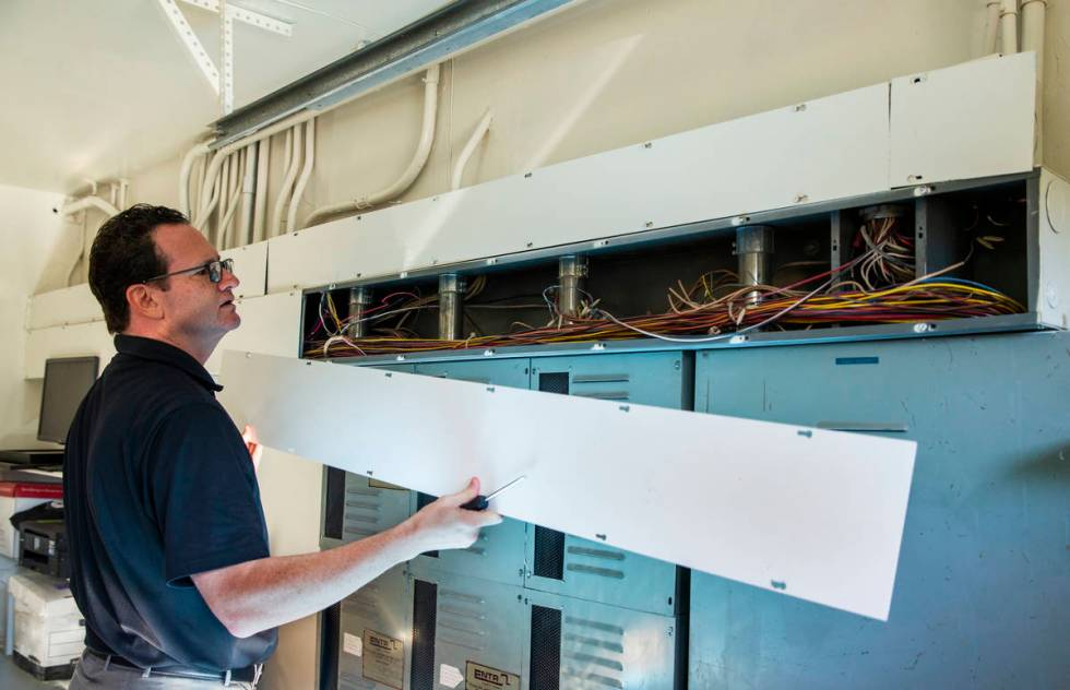 Owner Jim Morgan shows off some of the extensive wiring used for casino monitoring during a tou ...