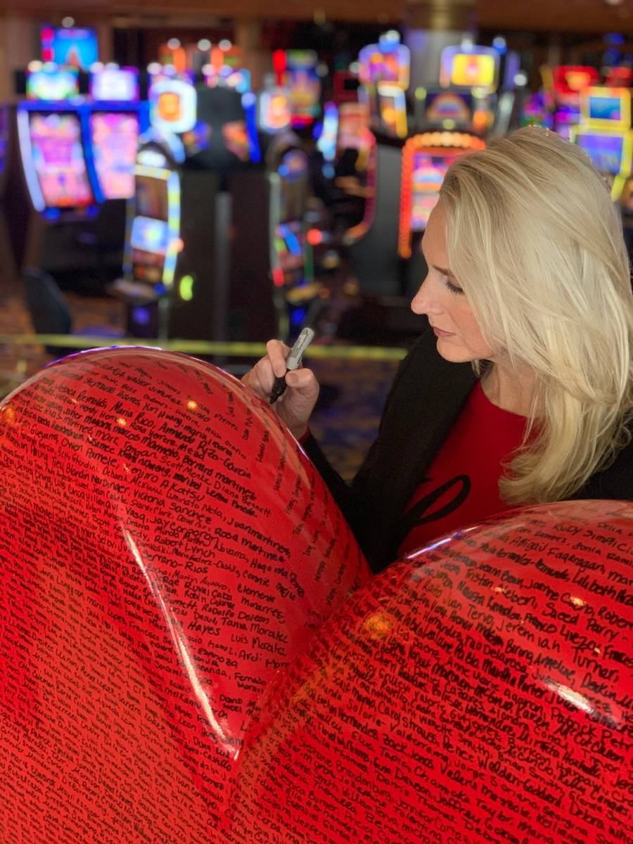Westgate Las Vegas General Manager Cami Christensen is shown writing an employee's name to the ...