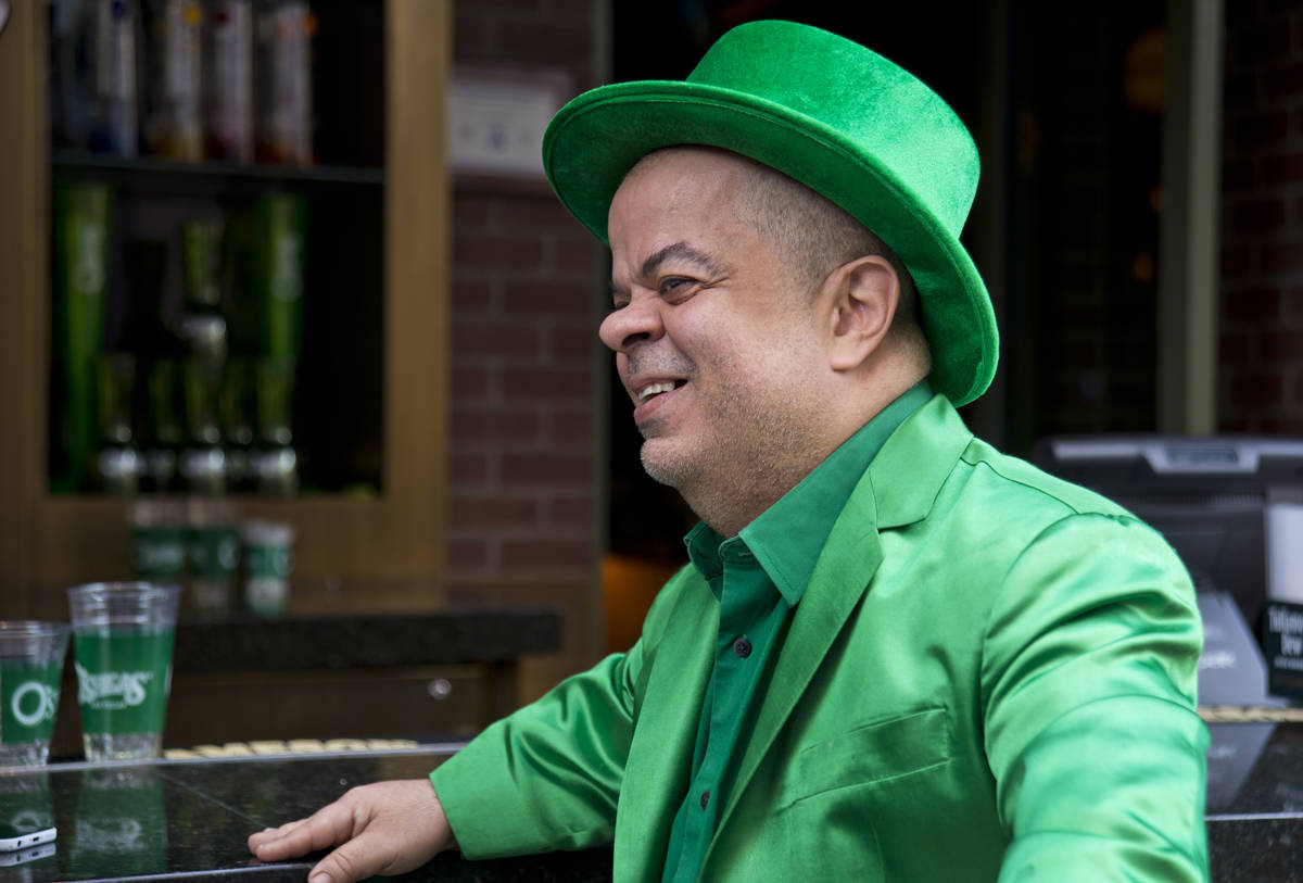 Brian Thomas, O'Sheas Casino manager and resident leprechaun, answers questions during an inter ...