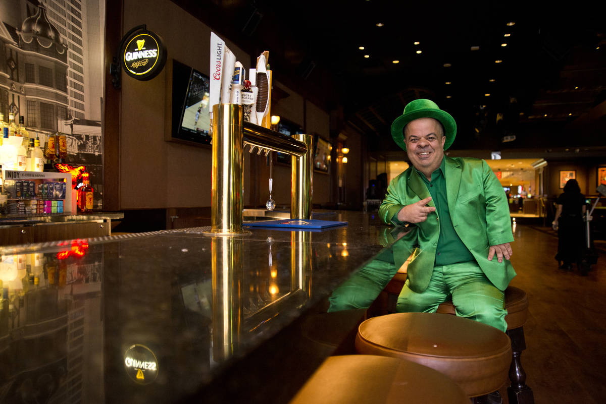 Brian Thomas, O'Sheas Casino manager and resident leprechaun, poses for a photograph inside the ...