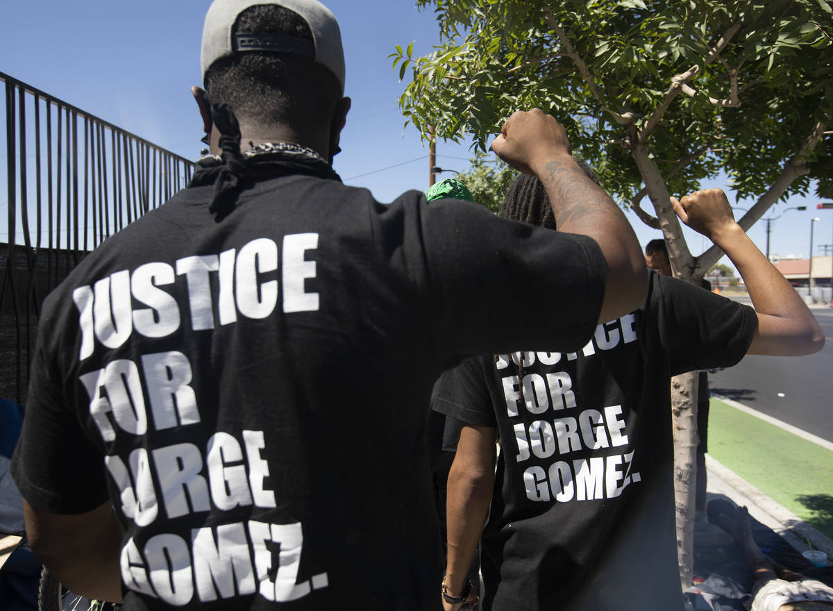 """Deonte Thurman, left, and Dre Thurman, right, wear shirts saying """"Justice for Jorge Gomez, ..."""