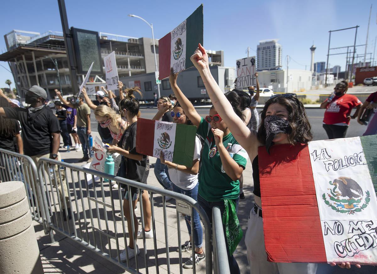Outside Las Vegas City Hall, Leslie Fausto, right, demonstrates in an effort to defund the Metr ...