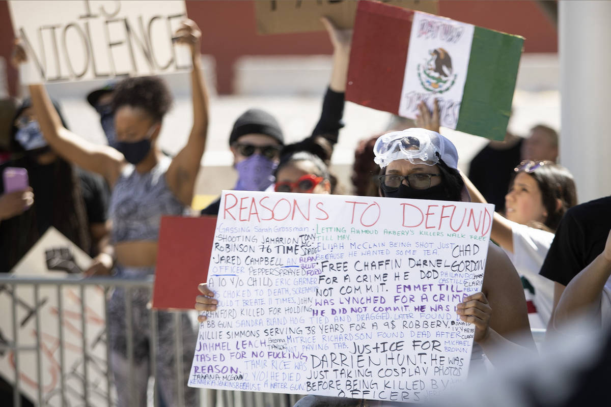 Demonstrators gather outside Las Vegas City Hall in an effort to defund the Las Vegas Metropoli ...