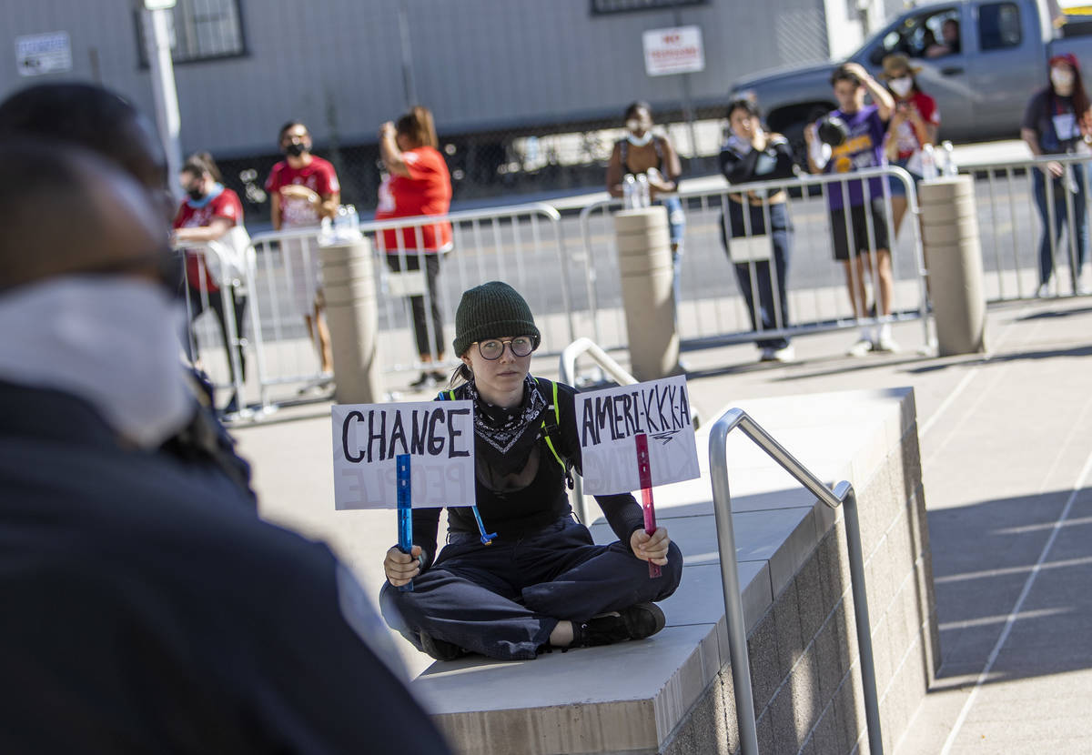 Erica Sommerfeld of Las Vegas sits in an area that police blocked off in anticipation of protes ...