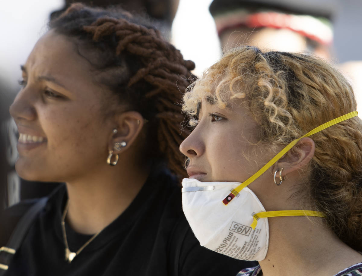Jayla Scott, left, and Fernanda Rivera, right, get emotional while protesting in an effort to d ...