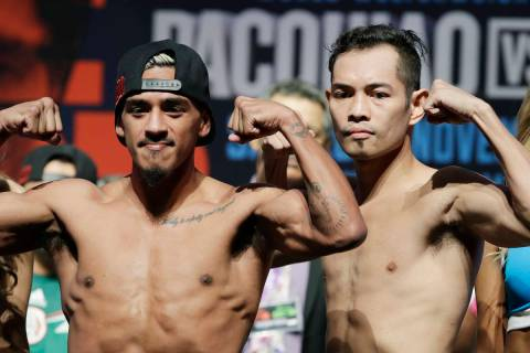 Nonito Donaire, right, of the Philippines, and Jessie Magdaleno pose during a weigh-in Friday, ...