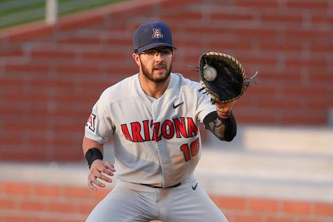 FILE - In this April 9, 2019, file photo, Arizona's Austin Wells catches a throw during the tea ...