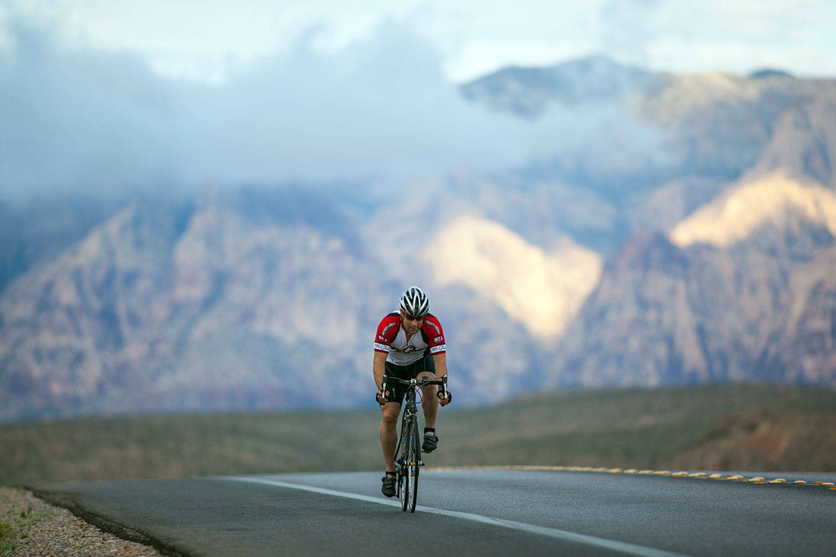 Cyclists ride along State Route 159 in Red Rock Canyon National Conservation Area in Las Vegas ...