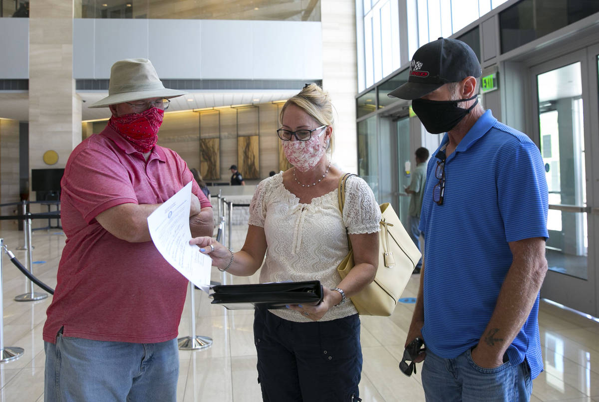 Molley Taylor, center, Expel Michele organizer, her husband Shawn, right, and Larry Confer, dis ...