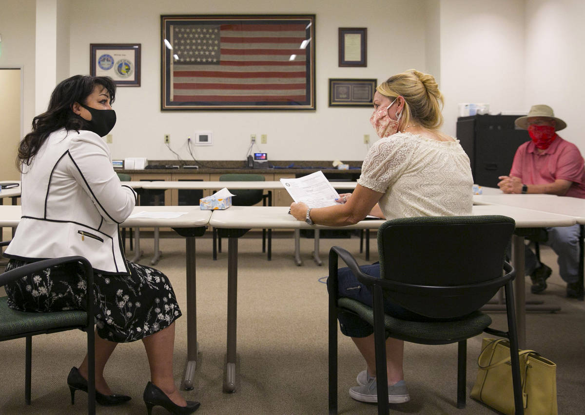 Stacey Campbell, left, chief deputy clerk at City of Las Vegas, and Molley Taylor, Expel Michel ...
