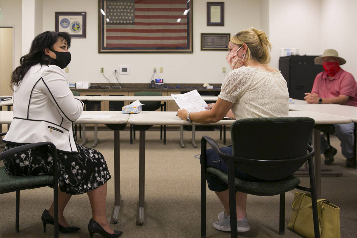 Stacey Campbell, left, chief deputy clerk at City of Las Vegas, and Molly Taylor, Recall Michel ...