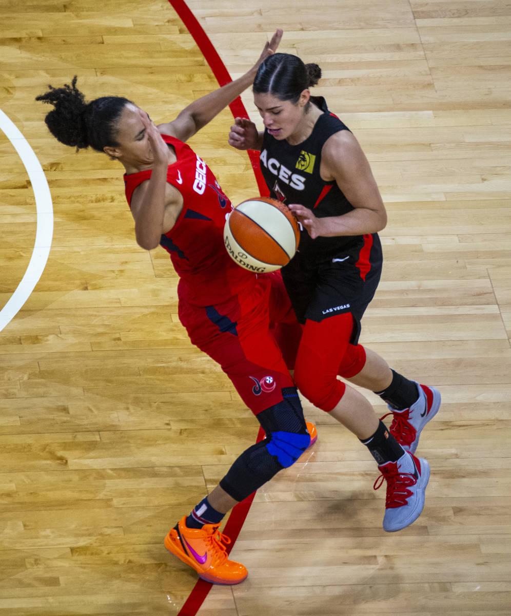 Washington Mystics guard Kristi Toliver (20, left) draws a critical charging foul late on Las V ...