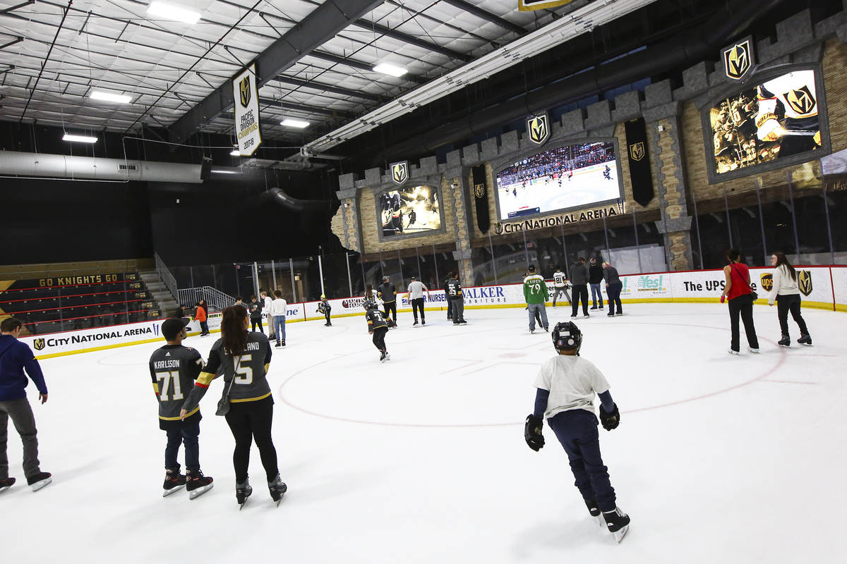 Golden Knights fans skate on the ice at City National Arena during a watch party for an away ga ...